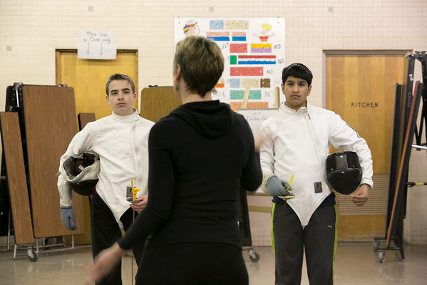 Photo/Reba Saldanha  Molly Sullivan Sliney leads the Tanner City Fencers Club as students Alex Vassilopoulos, left of Andover, and Pranav Abbott also of Andover listen at Higgins Middle School Wednesday April 6, 2016