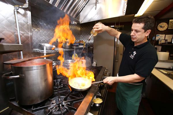 KEN YUSZKUS/Staff photo.    Owner Aleko Pashaj fries up some ingredients on the stove at Gallo Nero Restaurant in Peabody.     04/08/16