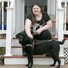 Photo/Reba Saldanha  Kayla Bentas and her service dog Haiku at her Peabody home Wednesday April 6, 2016