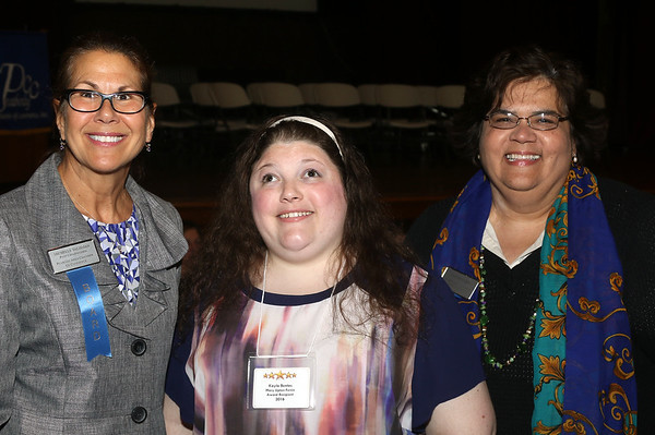 DAVID LE/Staff photo. Michelle Talisman, left, and Laura Swanson, right, Co-Chairs of the Community Service Committee and members of the Peabody Area Chamber of Commerce with Kayla Vertas, at the annual Mary Upton Ferris Award ceremony held in the Wiggin Auditorium at Peabody City Hall. 4/12/16.