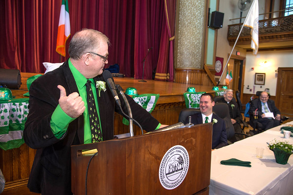 Desi Smith/Staff photo.      School Commity member Dave McGerey, pokes fun at Peabody Mayor Ted Bettencourt during Peabody's Fourth Annual St. Patrick's Day Breakfast and Roast held Saturday morning at City Hall.  March 12,2016