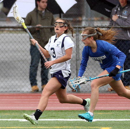 DAVID LE/Staff photo. Peabody's Kirsten Bradley (3) looks to make a pass against Methuen on Saturday afternoon. 4/2/16.