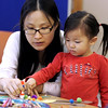 "KEN YUSZKUS/Staff photo.      Eunsil Lee helps her daughter Tiffany Bae create a paper leprechaun after listening to the stories, ""The Littlest Leprechaun"" and ""The Night Before St. Patrick's Day"" at the Mother Goose Story Time held at the South Branch Library in Peabody.    03/08/16"