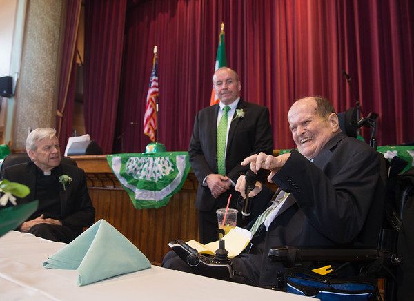 Desi Smith/Staff photo.     Former Senator Fred Berry (right) delivers some jokes as Emcce Tom Gould and Father John McGuinness look on during Peabody's Fourth Annual St. Patrick's Day Breakfast and Roast held Saturday morning at City Hall.  March 12,2016
