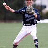 DAVID LE/Staff photo. Peabody shortstop Jake Gustin fires the ball to second to record a force out at second against St. John's Prep on Saturday afternoon. 4/8/16.