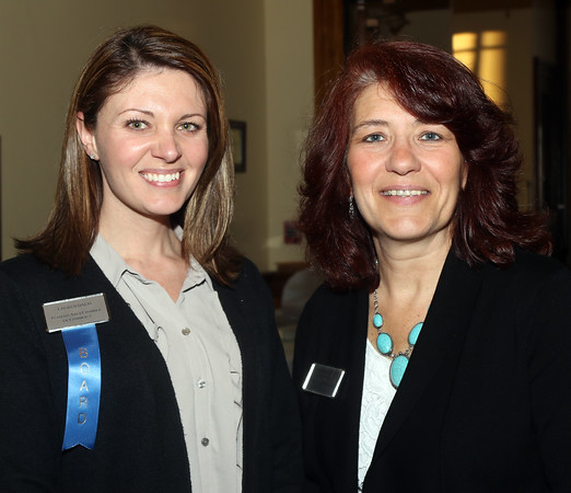DAVID LE/Staff photo. Lauren Dalis and Maggie Shanahan, of the Peabody Area Chamber of Commerce, at the annual Mary Upton Ferris Award ceremony held in the Wiggin Auditorium at Peabody City Hall. 4/12/16.