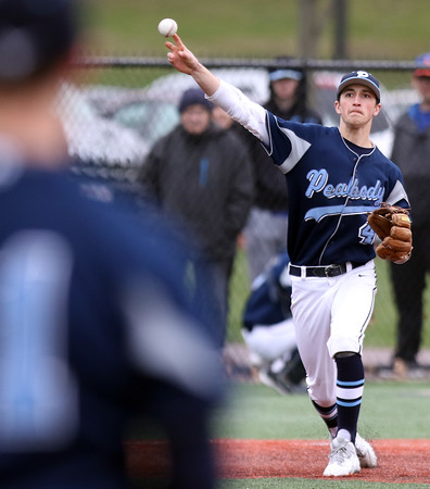 DAVID LE/Staff photo. Peabody third baseman Ben Irvine (4) fires over to first to retire a St. John's Prep runner. 4/8/16.