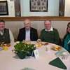 Desi Smith/Staff photo.      From left to right, Mike Schulz, Bob St.Pierre former Peabody police chief, Tom Griffin current Peabody police chief and Maripal Osborne settle in for Peabody's Fourth Annual St. Patrick's Day Breakfast and Roast held Saturday morning at City Hall.  March 12,2016