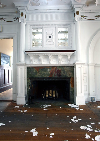 KEN YUSZKUS / Photo.    The fireplace on the 1st floor of the O'Shea Mansion. Flakes of ceiling paint  litter the floor.   3/21/17