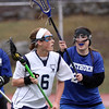 DAVID LE/Staff photo. Peabody's Amanda Bradley (6) looks to make a pass while being defended closely by Methuen's Victoria Bundzinski, right. 4/2/16.