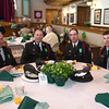 Desi Smith/Staff photo.      From left to right, Peabody Fire Honor Guard Steve Sullivan, Jay Dowling, Dan Pimewta and Sean Dolan settle in for Peabody's Fourth Annual St. Patrick's Day Breakfast and Roast held Saturday morning at City Hall. The group lead the way during the opening ceremony into city hall.   March 12,2016
