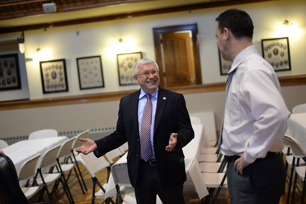 PAUL BILODEAU/Staff photo. Former Peabody Mayor Michael Bonfanti talks with current Mayor Ted Bettencourt in Peabody City Hall's Wiggin Auditorium.