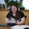 Photo/Reba Saldanha  Kayla Bentas uses a Braille Sense note taker and e-book reader at her Peabody home Wednesday April 6, 2016
