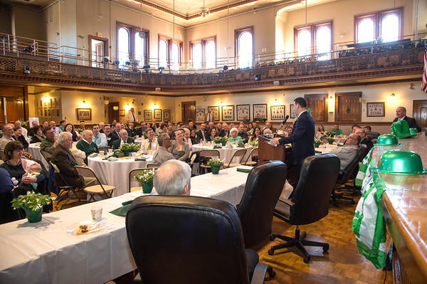 Desi Smith/Staff photo.  Peabody Mayor Ted Bettencourt delivers some jokes at the Peabody's Fourth Annual St. Patrick's Day Breakfast and Roast held Saturday morning at City Hall.  March 12,2016