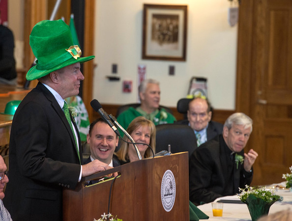Desi Smith/Staff photo.     Emcce Tom Gould pokes fun at Peabody Mayor Ted Bettencourt (right) as Senator Joan Lovely and others look on during Peabody's Fourth Annual St. Patrick's Day Breakfast and Roast held Saturday morning at City Hall.  March 12,2016