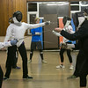 Photo/Reba Saldanha  Molly Sullivan Sliney, right, spars with student Ashley Goland of Boxford at the Tanner City Fencers Club practice at Higgins Middle School Wednesday April 6, 2016