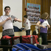Photo/Reba Saldanha  Tanner City Fencers Club participants (from left) Cam Santos, Wyatt Carlton, and Sara Earl put on their gear at Higgins Middle School Wednesday April 6, 2016