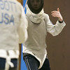 Photo/Reba Saldanha  Wyatt Carlton of Groveland, right, spars with Pranav Abbott of Andover at the Tanner City Fencers Club practice at Higgins Middle School Wednesday April 6, 2016