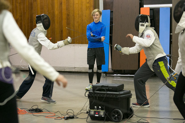 Photo/Reba Saldanha Student Matt Mills leads a drill during the Tanner City Fencers Club practice at Higgins Middle School Wednesday April 6, 2016