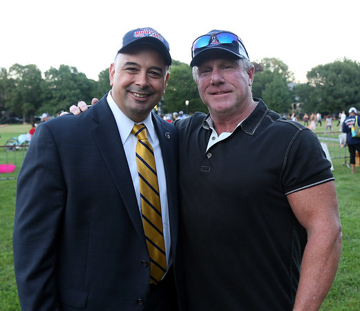 DAVID LE/Staff photo. Salem Police Department Court Prosecutor Dennis King, left, and Bill Riley, Union President, at the first annual National Night Out hosted by the Salem Police Department at the Salem Commons on Tuesday evening. 8/2/16.