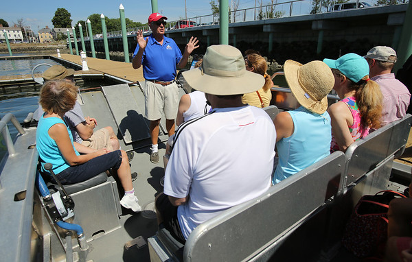KEN YUSZKUS/Staff photo.   Captain Ed Wolfe explains the trip to Bakers Island to a full boat while at the Salem Ferry dock before heading out to Bakers Island.  08/05/16