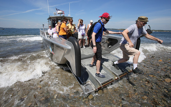 KEN YUSZKUS/Staff photo.    Passengers disembark from the boat, Naumkeag onto shore at Bakers Island.  08/05/16