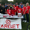 DAVID LE/Staff photo. A group from Target pose for a photo with members of the Salem Police Department at the first annual National Night Out hosted by the Salem Police Department at the Salem Commons on Tuesday evening. 8/2/16.