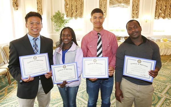 KEN YUSZKUS/Staff photo.    Salem High School students, from left, Renne Venico, Brenda Karanja, Ely Cruz, and Clarence Aroke received the Salem Rotary Club's Leadership and Service Award.      05/24/16