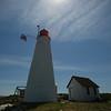 KEN YUSZKUS/Staff photo.   The sun shines on Bakers Island's lighthouse.    08/05/16