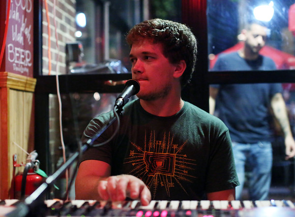 DAVID LE/Staff photo. Eric McEwen, keyboardist for the band Skyfoot, plays at Village Tavern in downtown Salem. 9/9/16.