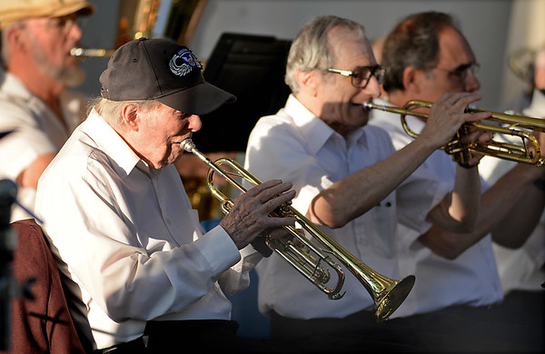 RYAN HUTTON/ Staff photo<br /> 99-year-old trumpeter Frank Higgins, left, plays along with the North Shore Concert Band at the Robert Hayes Bandshell at Salem Willows after having the first concert of the season dedicated to him and his years of playing with the band.