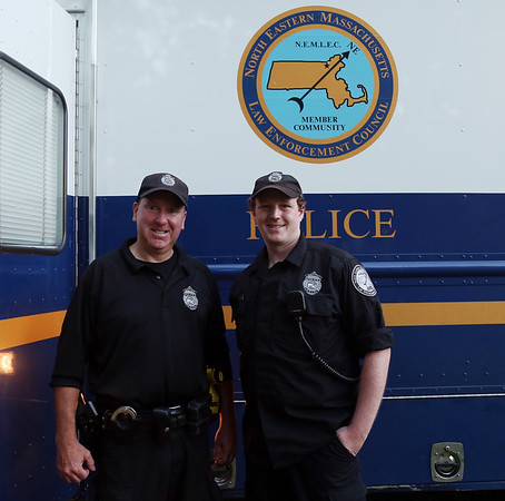 DAVID LE/Staff photo. Officer Dave Simonds, and Dispatcher Mike Griffin, of the Salem Police Department, at the first annual National Night Out hosted by the Salem Police Department at the Salem Commons on Tuesday evening. 8/2/16.