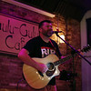 DAVID LE/Staff photo. Kevin Farren of Dillon Farren, an acoustic group, plays for a crowd at Gulu-Gulu on Friday evening. Gulu-Gulu Cafe in downtown Salem is one of the hotspots for live music. They have live music most nights of the week, with an open mic night on Wednesdays and live bands Thursday through Sunday. 9/9/16.