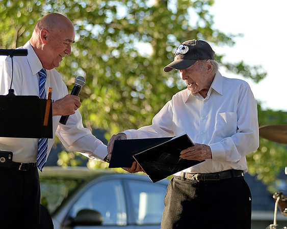 RYAN HUTTON/ Staff photo<br /> 99-year-old trumpeter Frank Higgins, right, receives a commendation from the Mayor of Salem from Bill Fylgre before the first performance of the North Shore Concert Band at the Robert Hayes Bandshell at Salem Willows on Thursday night.