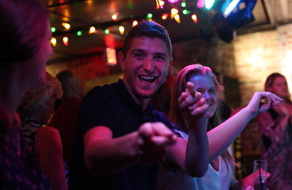 DAVID LE/Staff photo. Alex Dewsnap, of Peabody, enjoys the live band Mo Bounce in the basement of Opus in Salem on Friday evening. 9/9/16.
