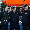 DAVID LE/Staff photo. From left, K9 Officer Jon Bedard, Capt Fred Ryan, and Officer Brian Butler, at the first annual National Night Out hosted by the Salem Police Department at the Salem Commons on Tuesday evening. 8/2/16.