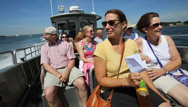KEN YUSZKUS/Staff photo.   In front, Mary Tuttle, left, and Rosemary Dunning, both of Salem, along with the rest of the passengers ride the boat, Naumkeag out to Bakers Island.  08/05/16