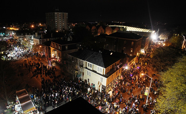 DAVID LE/Staff photo. The City of Salem was abuzz on Saturday evening as thousands upon thousands of people flocked to the Witch City to celebrate Halloween. Here an overview shot of many of the festivities is taken from the roof of the Hawthorne Hotel looking down at Essex Street and Washington Square East. 10/31/15.