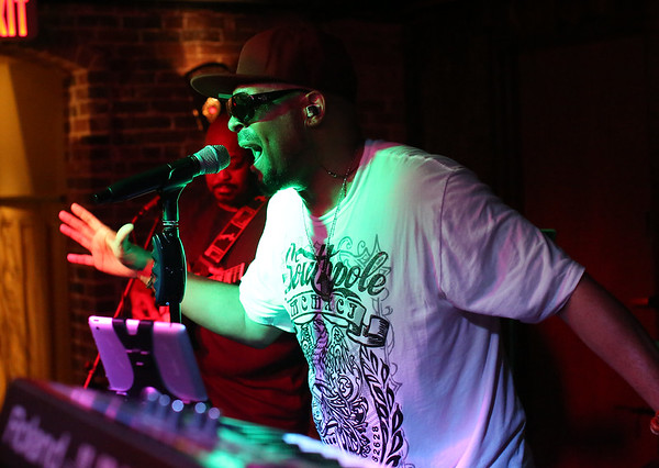 DAVID LE/Staff photo. Brendunt Scott, lead singer of Mo Bounce, a Boston based live funk band, entertains a crowd at Opus. 9/9/16.