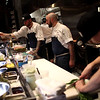 HADLEY GREEN/Staff photo<br /> Line cooks prepare meals at Ledger, a new restaurant in downtown Salem inhabiting the old Salem Savings Bank building. 8/02/17