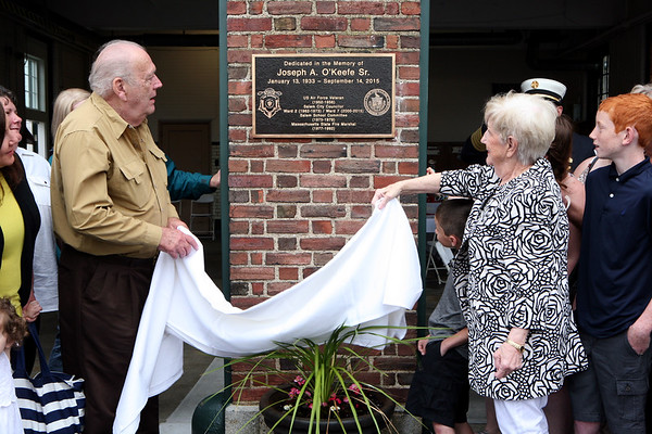 AMY SWEENEY/Staff photo. The Salem Fire Station on Loring Ave was dedicated to Joseph A. O'Keefe, Sr. on June 17. O'Keefe's wife Camille  and brother Edward unveiled the plaque. Joseph O'Keefe, was a beloved city official who died in September 2015 and had a long and celebrated tenure on City Council. O'Keefe also served as state fire marshal from 1977 to 1992. <br /> June 17, 2017