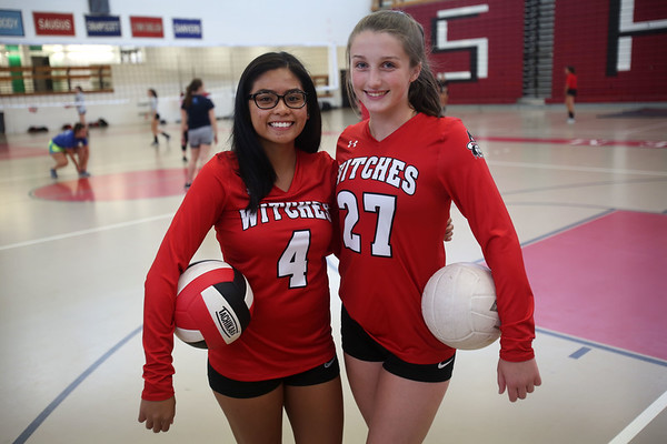 HADLEY GREEN/Staff photo<br /> Seniors Sandrei Agno and Brianna Sano, captains of Salem High's girls varsity volleyball team, stand in the Salem High field house during practice. 8/25/17