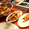 HADLEY GREEN/Staff photo<br /> A cook plates french fries at Ledger, a new restaurant in downtown Salem inhabiting the old Salem Savings Bank building. 8/02/17