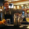 HADLEY GREEN/Staff photo<br /> Bar manager Mathew Gundaker pours wine. 8/02/17