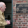 AMY SWEENEY/Staff photo. Edward O'Keefe, looks at the plaque on the Salem Fire Station that was dedicated to his late brother Joseph O'Keefe, a beloved city official who died in September 2015.  The station was dedicated on June 17, 2017.