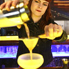 KEN YUSZKUS/Staff photo.      Opus bartender Ramona Shah makes a Wingstroke cocktail.      05/05/16