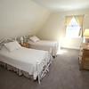 KEN YUSZKUS/Staff photo.    One of the bedrooms of the multi guest family suite on the 3rd floor of the renovated Salem Inn's Peabody House.     04/05/16