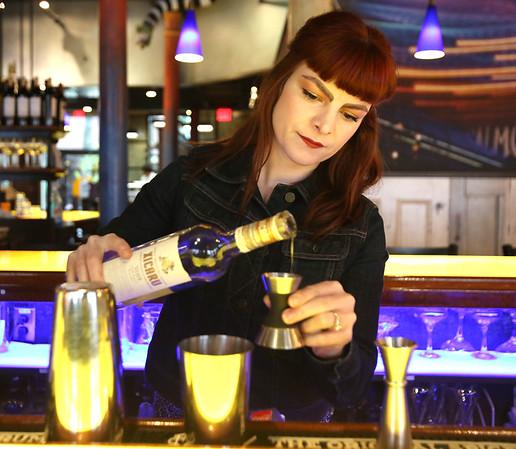 KEN YUSZKUS/Staff photo.      Opus bartender Ramona Shah makes a Wingstroke cocktail.      05/05/16