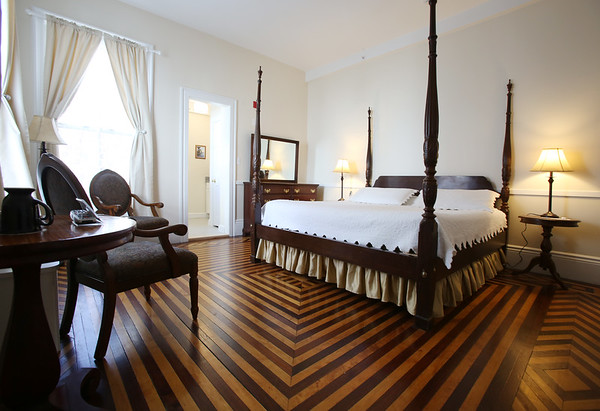 KEN YUSZKUS/Staff photo.    One of the two honeymoon suites at the renovated Salem Inn's Peabody House. The distinctive wood flooring is made of cherry and maple.    04/05/16