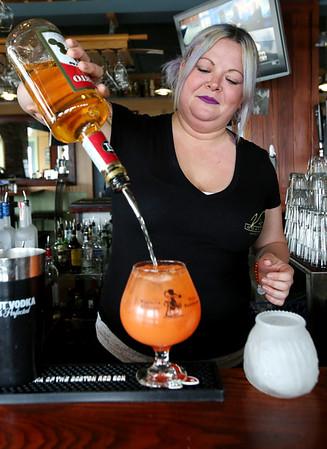 KEN YUSZKUS/Staff photo.       Victoria Station's bartender Jackie Schreibman prepares a Wharf Rat cocktail.          05/04/16